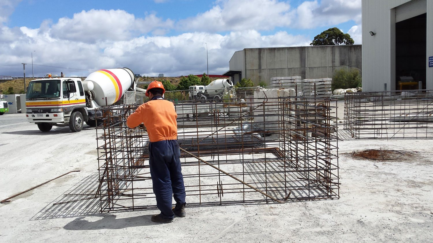 man working on precast unit made of cut and welded rebar.