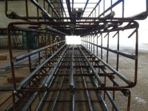 Prefabricated reinforcing cage made of cut and bent rebar for concrete column.